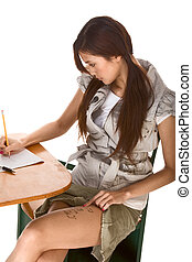Asian schoolgirl is preparing to cheat on test