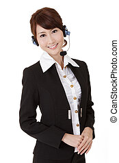 Asian secretary woman with headphone smiling and looking at...
