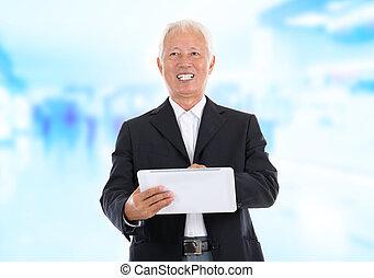 Asian senior businessman using tablet-pc