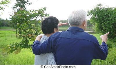 asian senior couple in the park