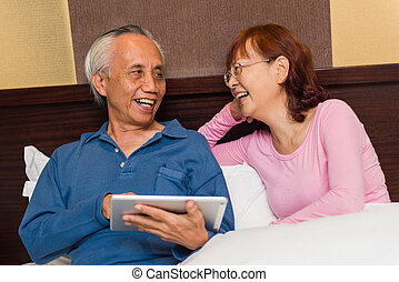 Asian senior couple laughing