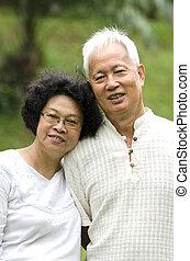 asian senior couple outdoor portrait