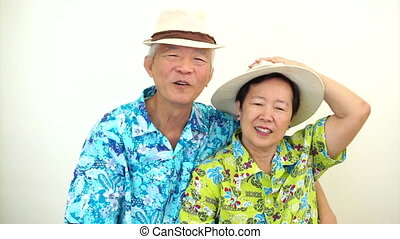 Asian senior couple victory sign