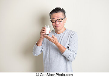 asian senior drinking milk