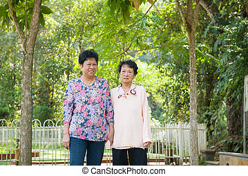 Asian senior females walking in the park