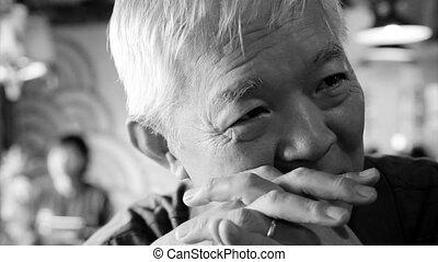 Asian senior guy talking restaurant