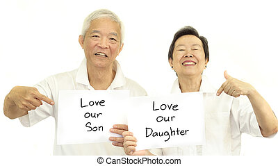 Asian senior parent couple with sign saying love their Children son and daughter