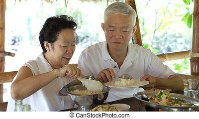 Asian senior talking care couple