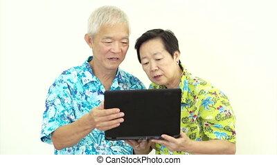 Asian senior video call travel