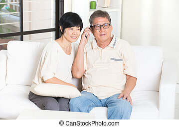 asian senior with smartphone