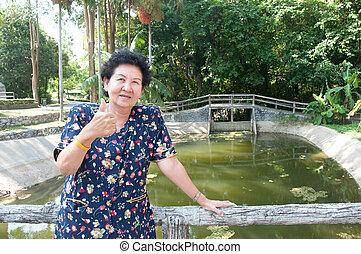asian senior woman in park