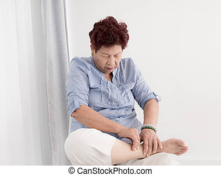 Asian Senior woman relax at home.