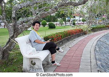asian senior woman sitting on chair
