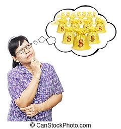 Asian senior woman thinking to money bags