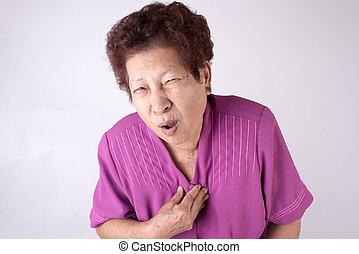 Asian senior woman with heart pain over gray background