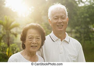Asian seniors couple at nature park