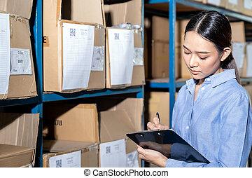 Asian smart businesswoman do inventory