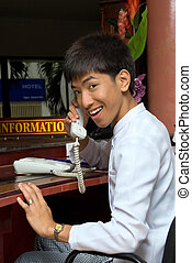 Asian smiling hotel receptionist
