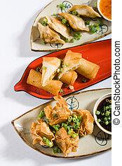 asian snacks - asian style snacks of deep fried dumplings ...