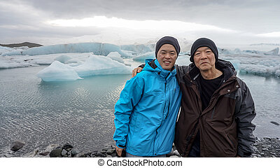 Asian son taking father to Iceland to see glacier lagoon