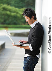 Asian student and laptop