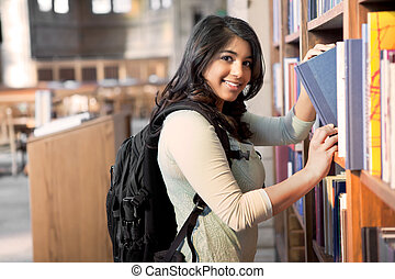Asian student in library - A shot of an asian student ...