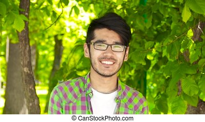 Asian student man looking in camera and smiling
