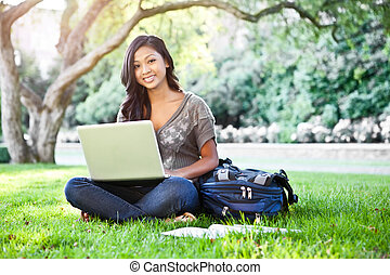 Asian student on campus - A shot of an Asian student working...