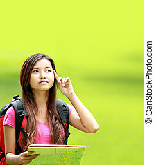 asian student thinking something in the park