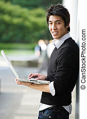 Asian student with laptop - A shot of an asian student...