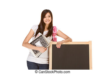 Asian student with notebooks by chalk board