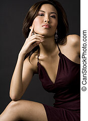 Asian Style - A beautifully poised asian model in an evening...