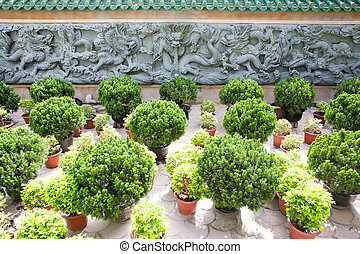 Asian style dragon stone pattern on a wall in the garden