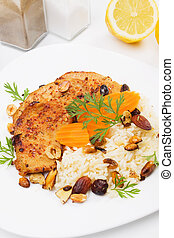 Asian style pork chops with rice and roasted nuts