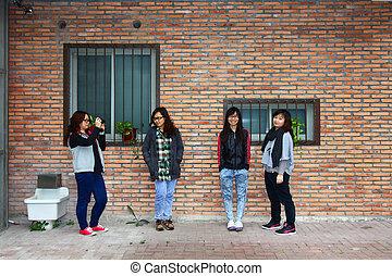 Asian stylish female friends