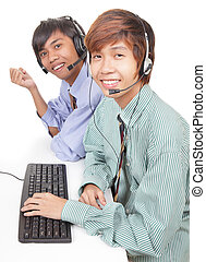 Asian support center agents - Two Asian call center agents...