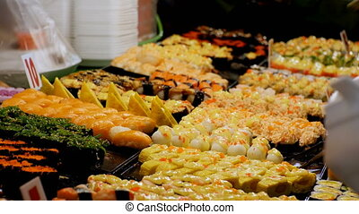 Asian Sushi on the Counter in the Night Food Market of...