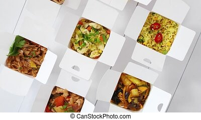 Asian take away or delivery food concept. Paper boxes placed...