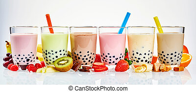 Asian tea house advertising banner of a choice of different flavored boba teas surrounded with fresh fruit ingredients, and caramel and chocolate candy in a wide panoramic header format on white