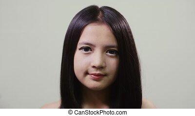 Asian teen looking at camera, girl