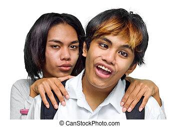 Asian teenage couple quarreling