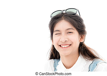 Asian teenage girl smiling and looking into the camera. Isolated on white background