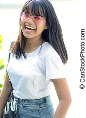 asian teenager laughing with happiness emotion