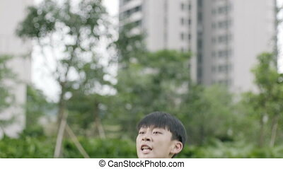 Asian teenager soccer player jumping & cheering after...