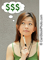 Money Matters - Asian Teenager Thinking of Money Matters...