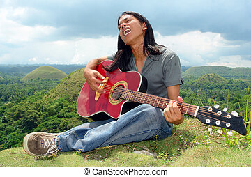 Asian teenager with guitar
