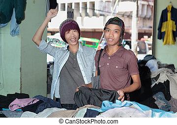 Asian teens shopping in oriental bazaar
