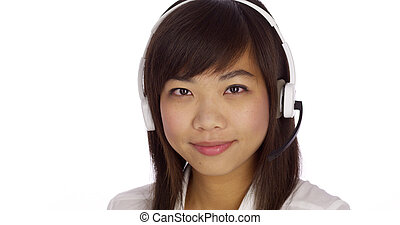 Asian telemarketer looking at camera