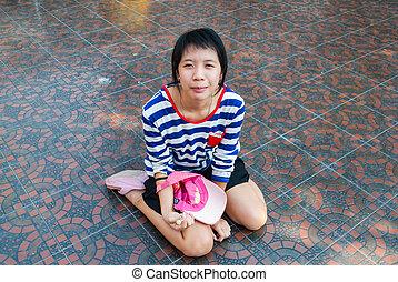 Asian Thai Girl Sitting on the Floor