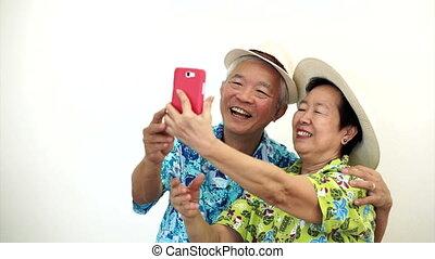 Asian tourist senior taking selfie
